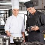 Chefs Preparing Food In Kitchen — Stock Photo #22222211