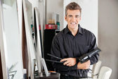Male Hairstylist With Hairdryer And Straightener — Stock Photo