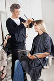 Hairstylist Cutting Customer's Hair In Parlor — Stock Photo