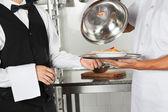 Chef Giving Pasta Dish To Waiter — Stock Photo