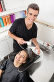 Hairstylist Washing Client's Hair In Parlor — Stock Photo