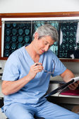 Medical Professional Reading Document — Stock Photo