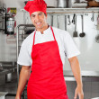 Stock Photo: Chef Standing In Commercial Kitchen