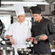 Male chefs Preparing Food Together — Stock Photo