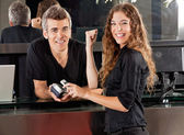 Happy Woman Paying Through Cellphone At Salon Counter — Foto Stock