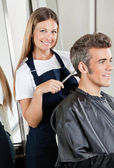 Hairdresser Cutting Client's Hair In Salon — Stock Photo