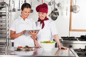 Female Chefs Using Digital Tablet — Stock Photo