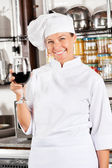 Happy Chef Holding Glass Of Red Wine — Stock Photo