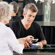 Customer Paying Through Mobile Phone At Salon — Stock Photo #22497771