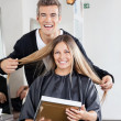 Stock Photo: Hairstylist With Client Holding Mirror At Salon