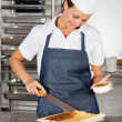 Female Chef Preparing Chocolate Roll — Stock Photo