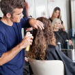 Hairstylists Setting Up Customer's Hair - Stock Photo