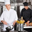 Happy Chefs Preparing Food — Stock Photo