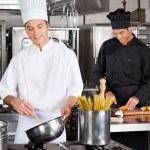 Happy Chefs Preparing Food — Stock Photo