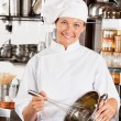 Female Chef With Wire Whisk And Mixing Bowl — Stock Photo