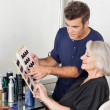 Hairstylist Choosing Hair Color For Customer - Stock Photo