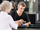 Customer Paying Through Mobile Phone At Salon — Foto Stock