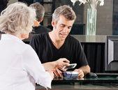 Customer Paying Through Mobile Phone At Salon — Stock Photo