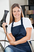 Female Hairdresser Holding Hairdryer — Stock Photo