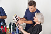 Hairstylist Choosing Hair Color For Customer — Stock Photo