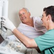Patient Looking At Ultrasound Machine — Foto Stock