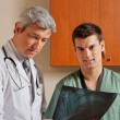 Male Technician With Radiologist - Stock Photo