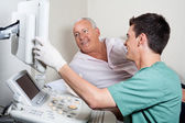 Patient Looking At Ultrasound Machine — Stock Photo