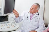 Radiologist Showing Something At Screen — Stock Photo