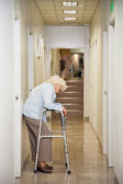 Elderly Woman Standing In Passageway — Stock Photo
