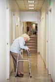 Elderly Woman Standing In Passageway — Stock Photo