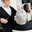 Stock Photo: Hairstylist Cutting Hair At Salon