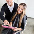 Hairstylist With Client Using Digital Tablet — Stock Photo