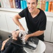 Stock Photo: Hairstylist Washing Customer's Hair