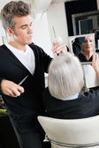 Hairstylist Cutting Hair At Salon — Stock Photo