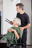 Woman With Coffee Cup And Hairdresser Holding Straightener — Stock Photo