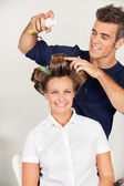 Customer With Hairstylist Setting Curls With Hairspray — Stock Photo