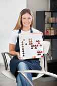 Hairstylist With Color Catalog At Salon — Stock Photo