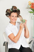 Female Client Removing Curlers — Stock Photo