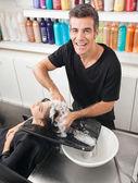 Hairstylist Washing Customer's Hair — Stock Photo
