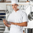 Young Chef Holding Tablet With Pasta Dishes At Counter — Stock Photo
