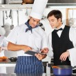 Waiter And Chef Using Digital Tablet In Kitchen — Foto Stock
