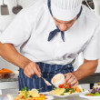 Stock Photo: Chef Garnishing Dish With Mayonnaise