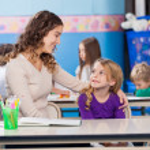 Little Girl Looking At Kindergarten Teacher — Stock Photo #25793553