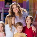 Happy Teacher With Cute Children In Preschool — Stock Photo #25793605