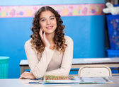 Teacher With Hand On Chin Sitting At Desk — Foto de Stock