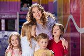 Happy Teacher With Cute Children In Preschool — Stock Photo