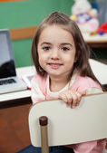Girl Sitting On Chair With Laptop On Desk In Classroom — Stock Photo