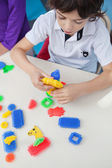 Boy Playing With Blocks At Desk In Kindergarten — Stock Photo