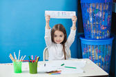 Girl Showing Drawing In Classroom — Stock Photo