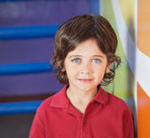 Boy In Casuals Smiling In Preschool — Foto Stock